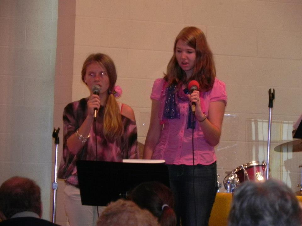 Youth singing in Sunday morning worship