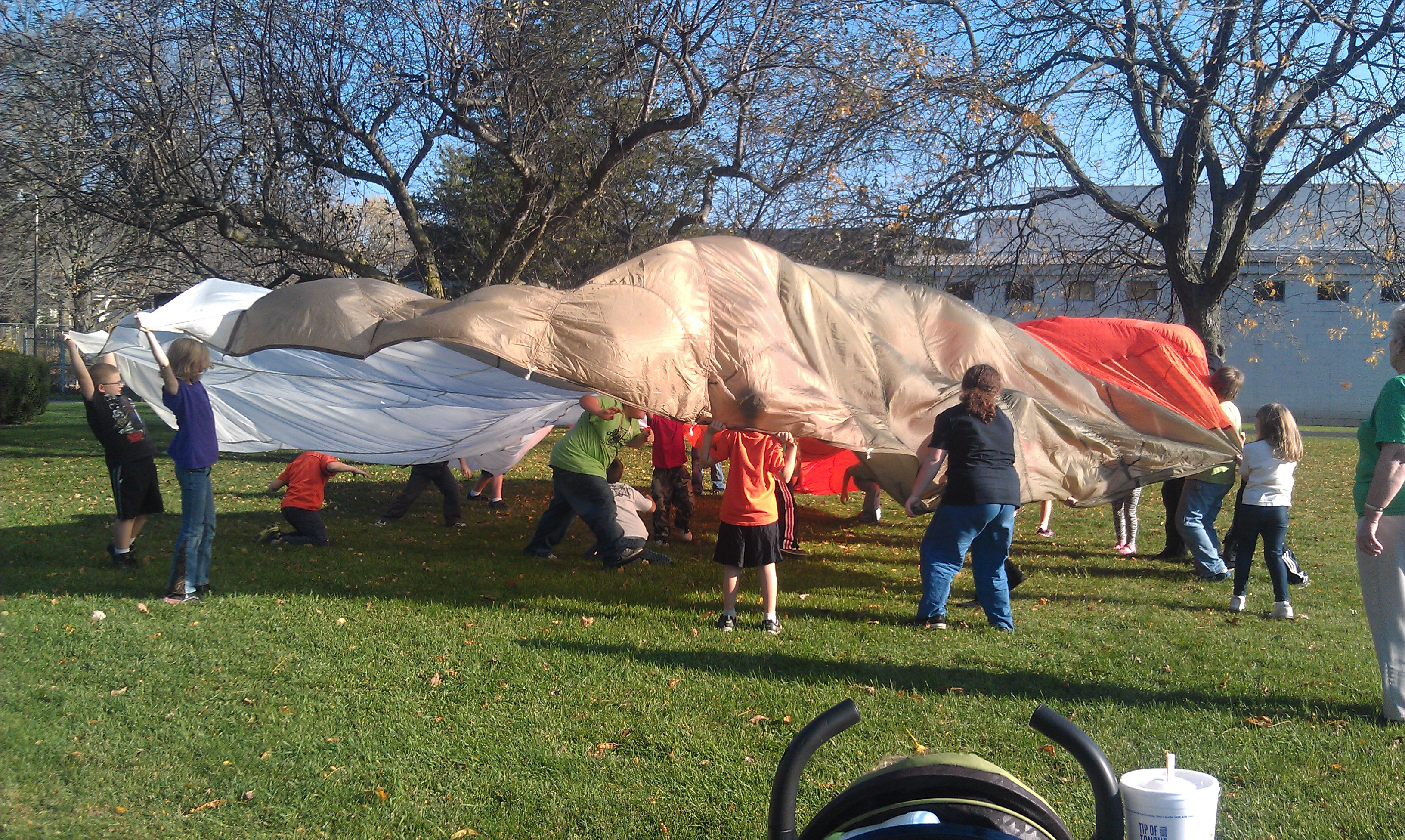 Good Stuff Club kids playing with a parachute